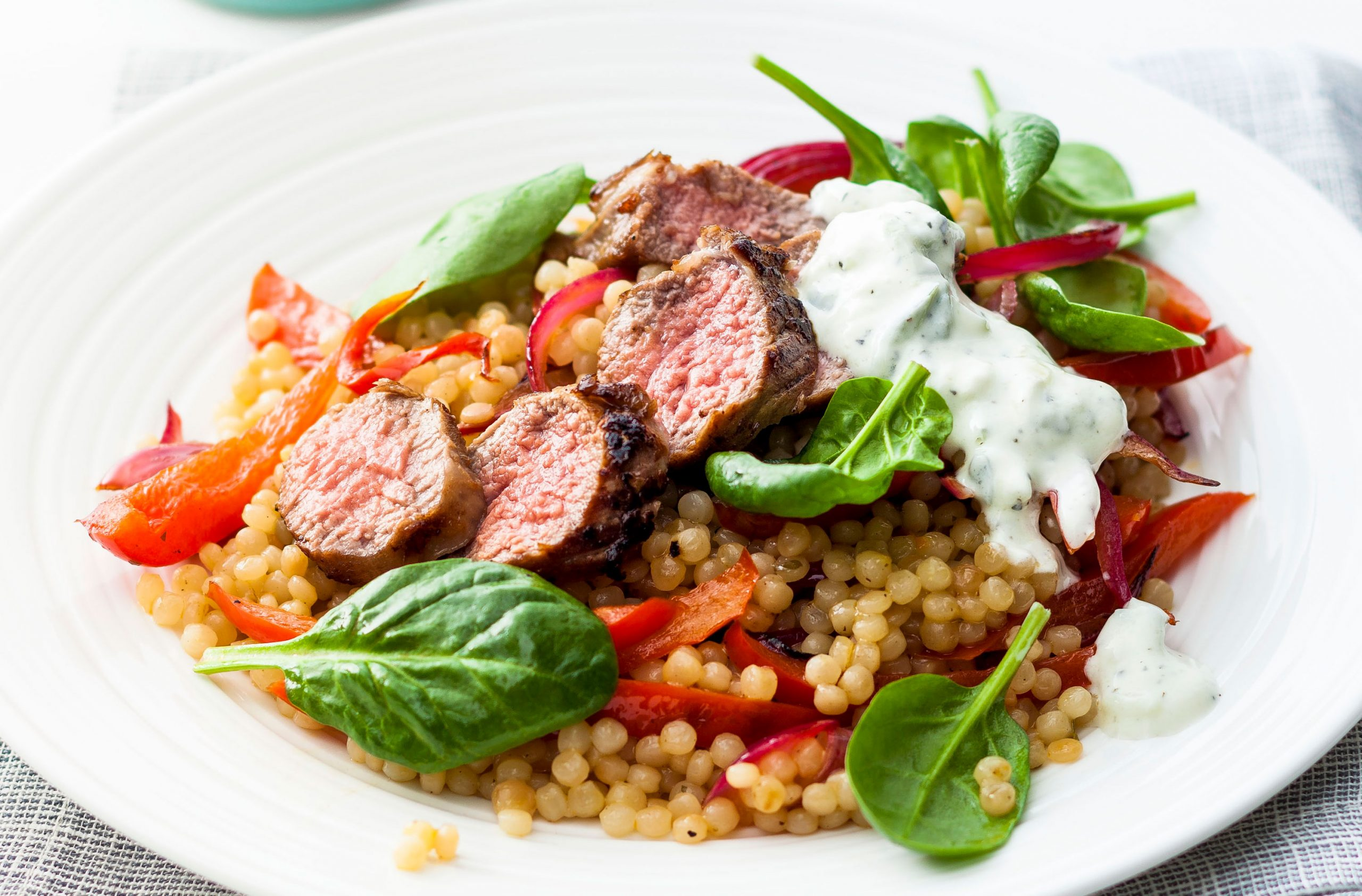Pan fried lamb with giant couscous salad