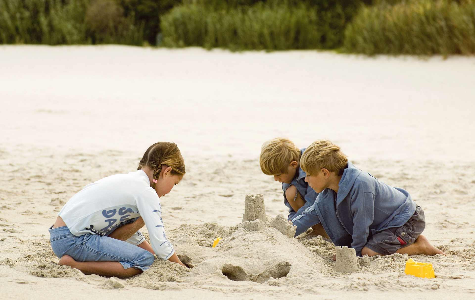 children building sandcastles