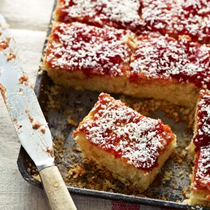 Have a go at making these jammy coconut square complete with surprise ingredient