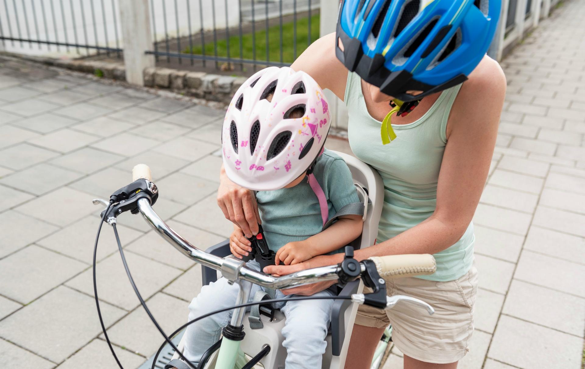 Mum and child in bike helmets