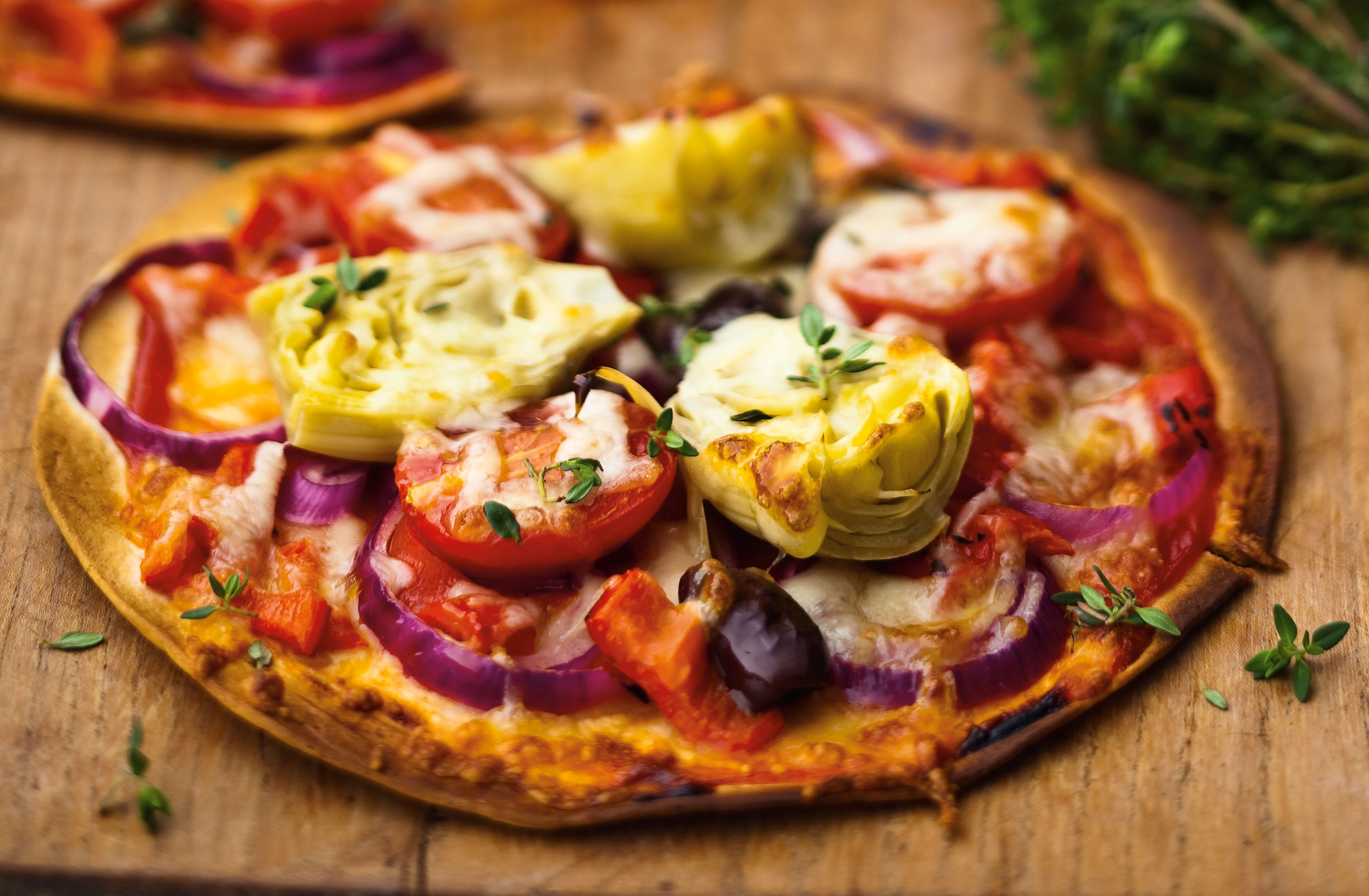 Red Onion Artichoke And Tomato Pizza