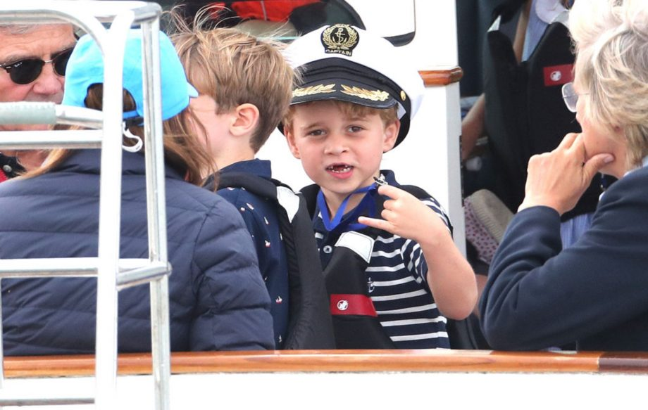 Princess Charlotte sticks out tongue as she and brother Prince George watch mum and dad compete at the King's Cup