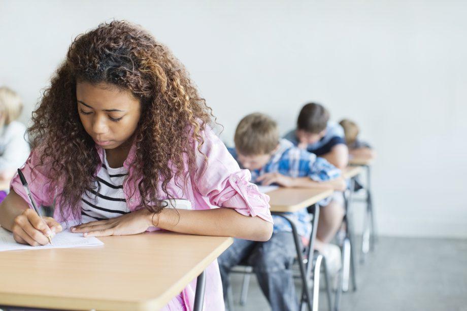 students taking exams in a hall - autumn exam retakes 2020