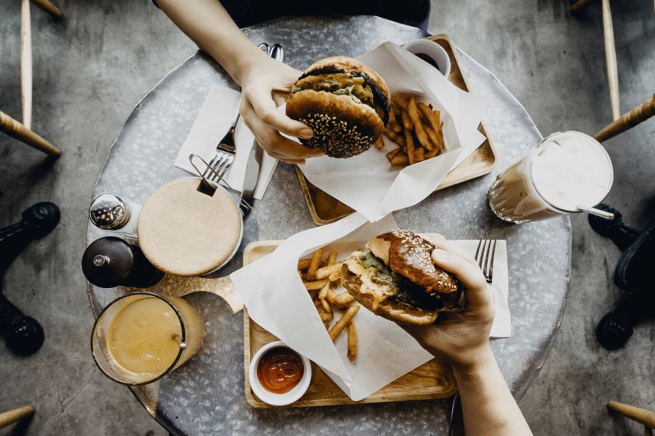 Avoid relationship weight gain: couple sharing burgers together