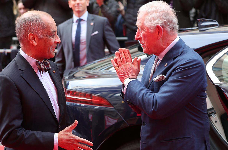 royal family response coronavirus shaking hands