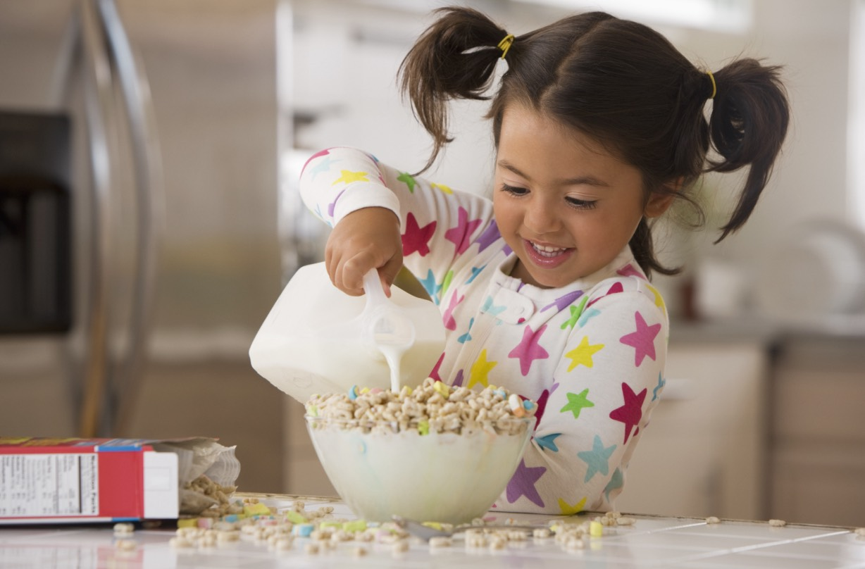 Girl making cereal