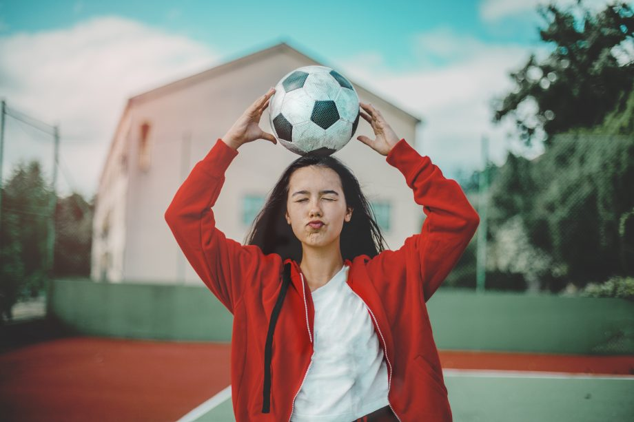 woman holding football