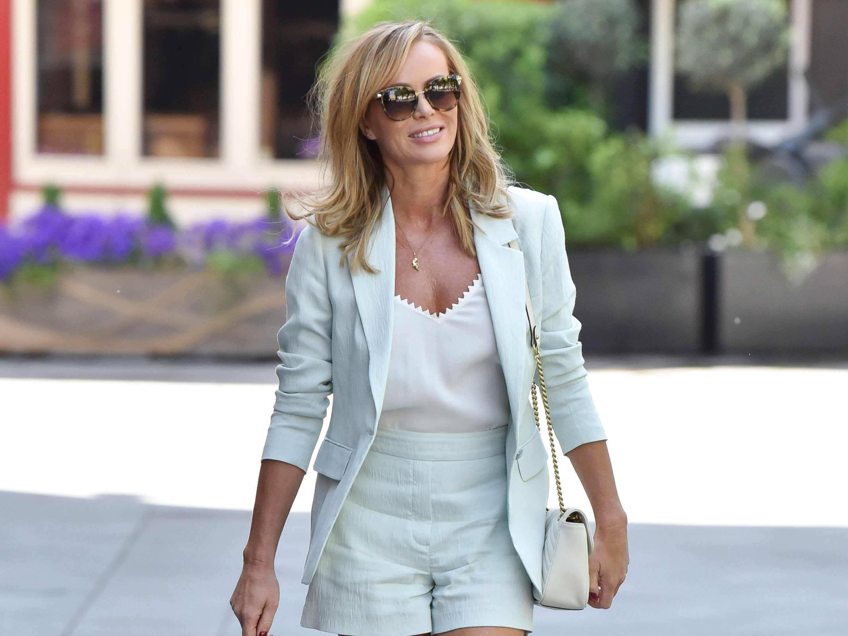 Fans noticed something seriously strange in Amanda Holden's latest family photo