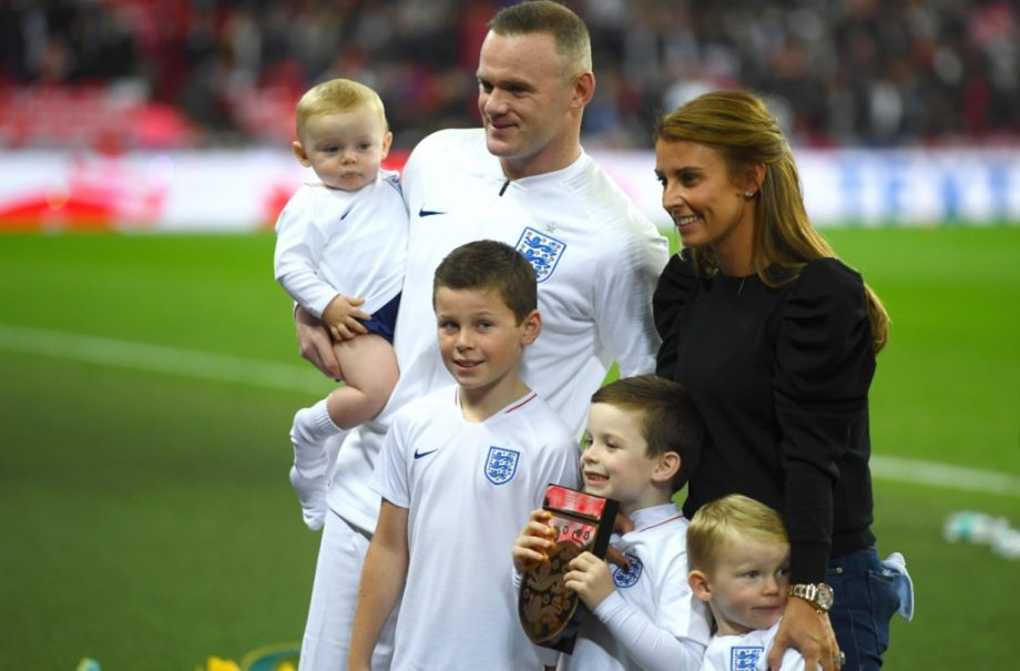Wayne Rooney and wife Coleen with their sons