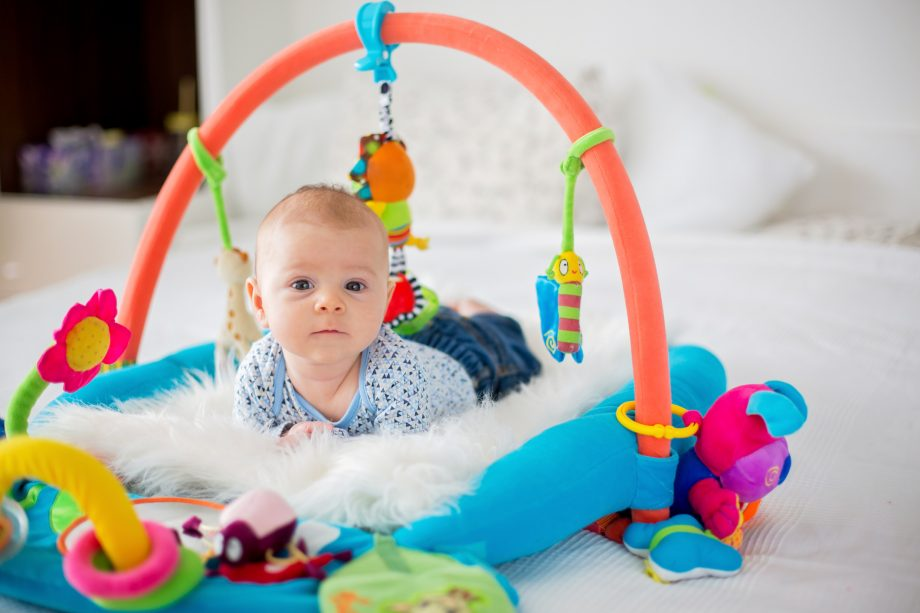 Baby playing in sensory play gym.