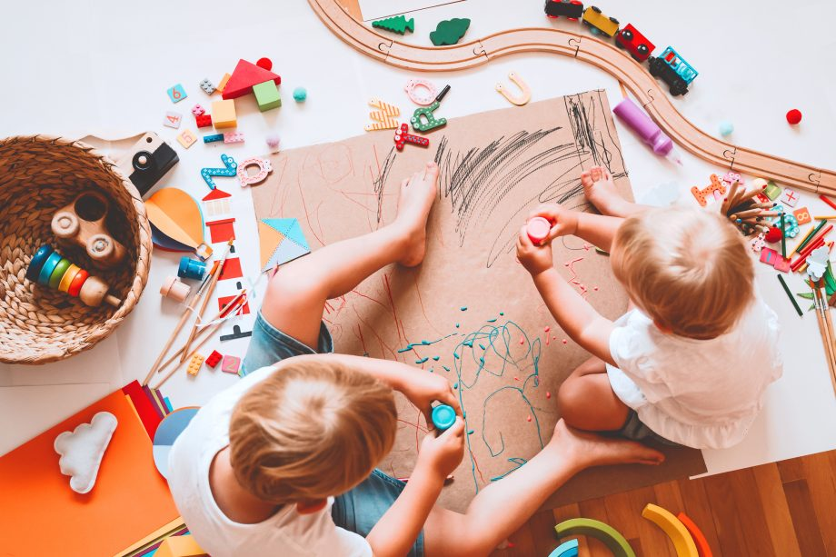Two boys playing with toys for three year olds.