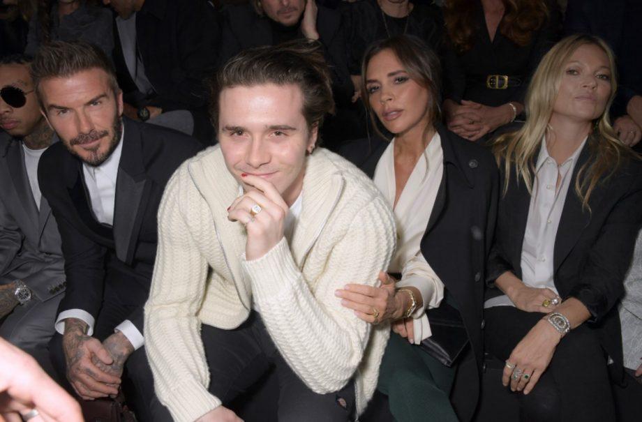 Brooklyn Beckham with parents David and Victoria Beckham
