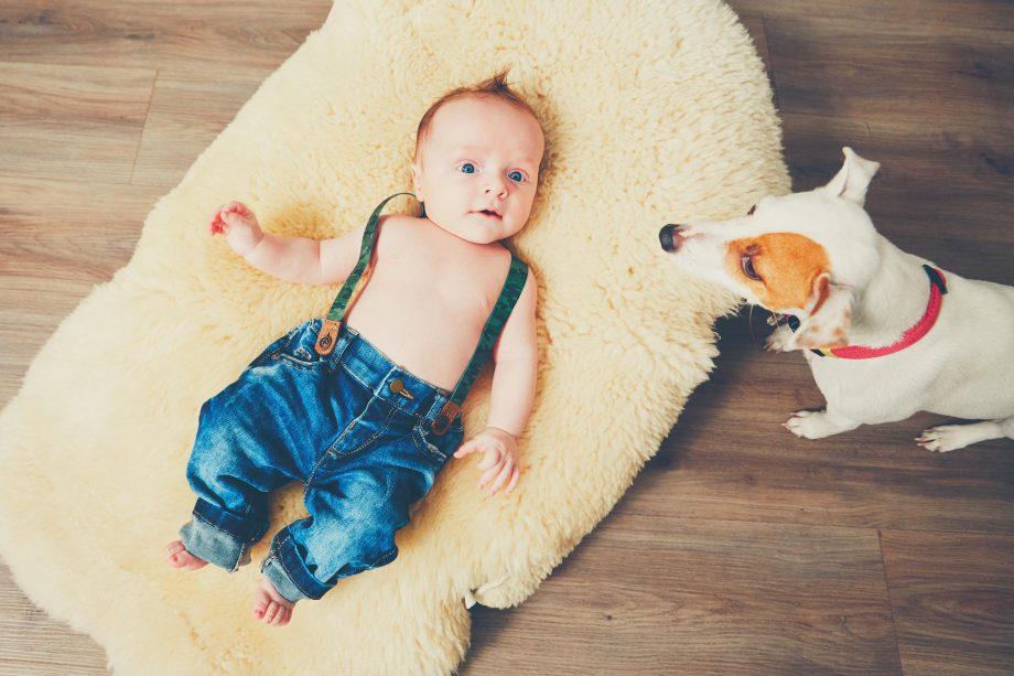 Design baby names - baby in fashioable clothes on a rug