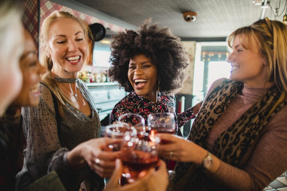 Group of women drinking wine wrong