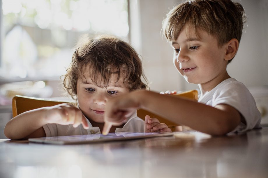 kids playing on iPad