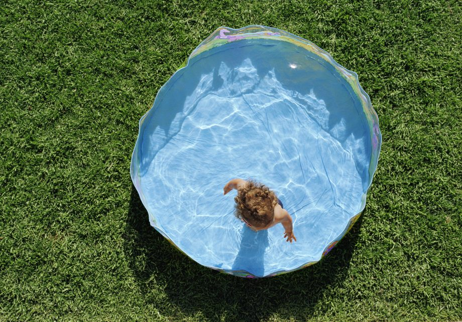child in a paddling pool