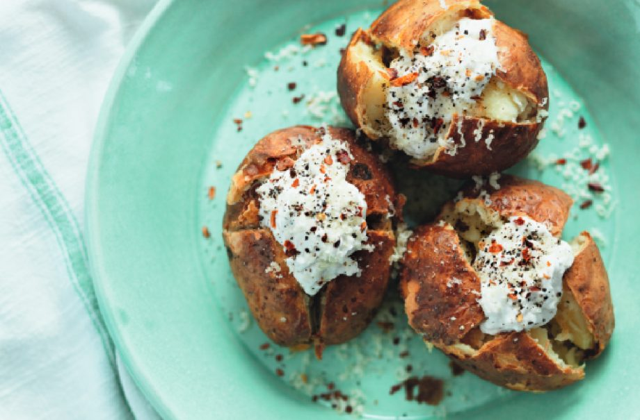 the best ever baked potatoes on a blue plate