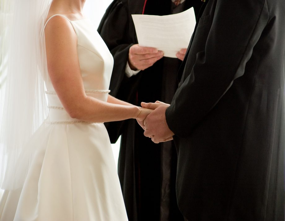 Cheeky groom confers with his ushers before deciding to say, 'I do' to his wife-to-be