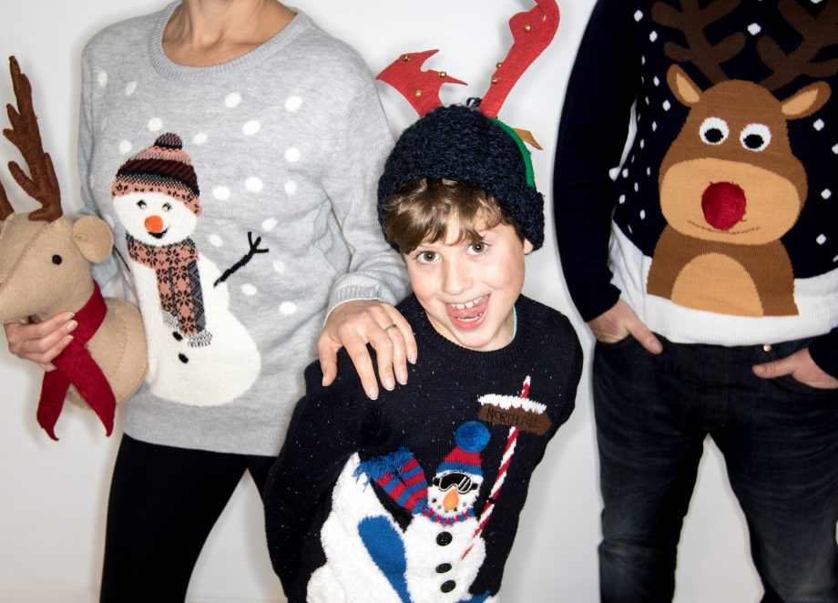 portrait of family wearing Christmas jumpers for Christmas Jumper Day 2020