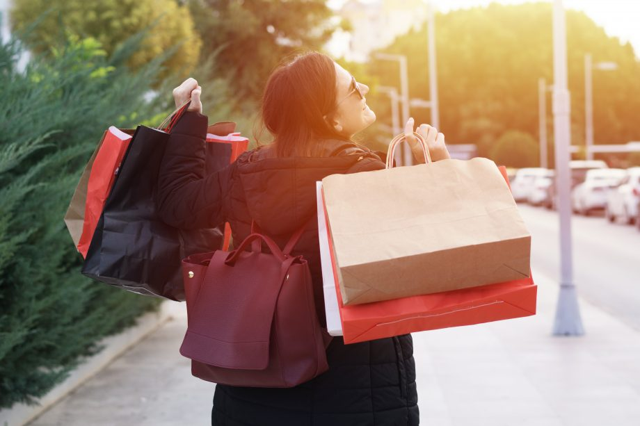 woman with bags after black friday deals 2020 UK