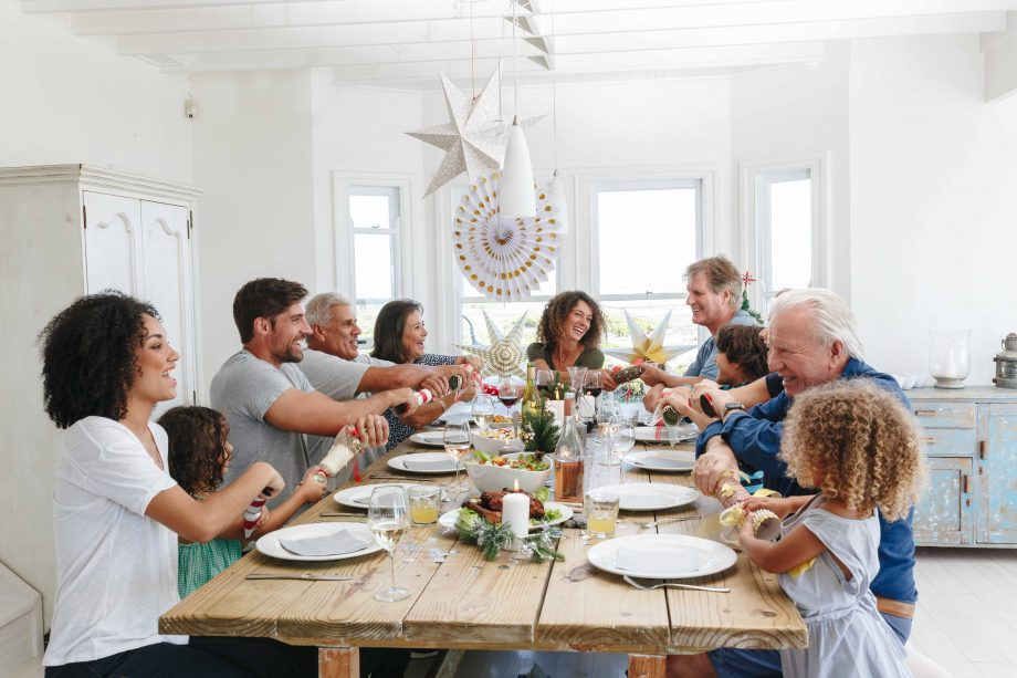 family around the table at Christmas during lockdown rules