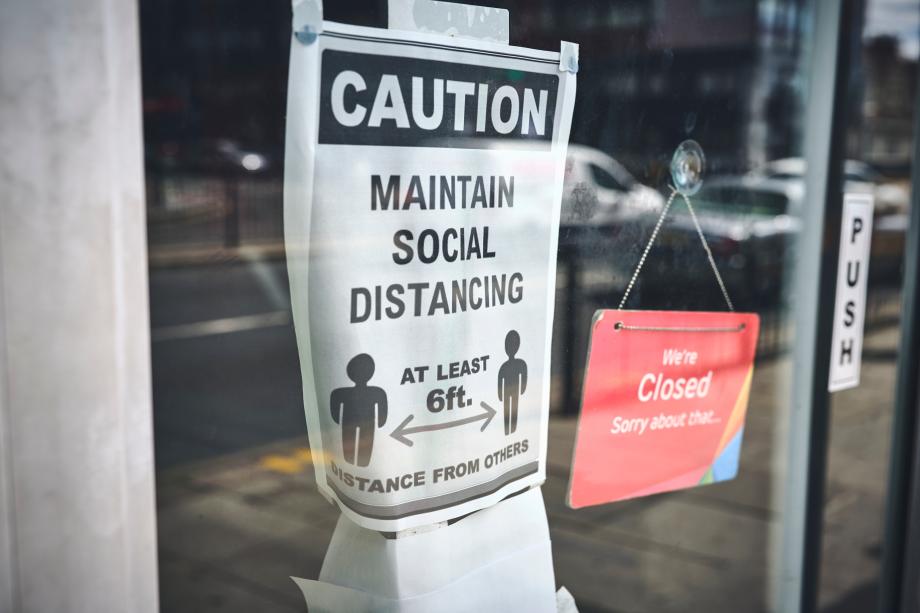 Covid-19 lockdown sign on shop door front