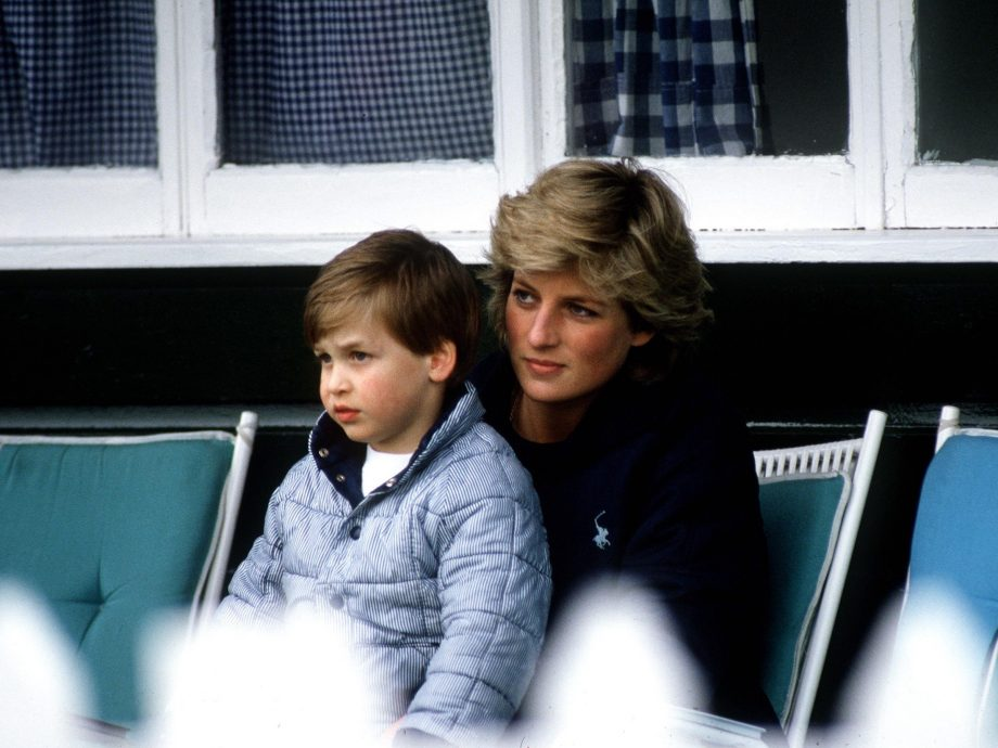 Princess Diana sits with Prince William on her lap