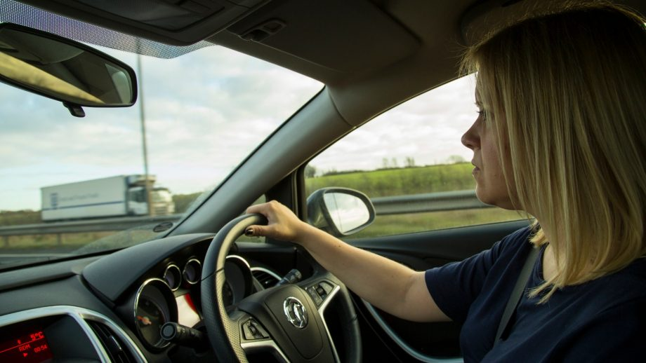 Woman driving a car, driving license