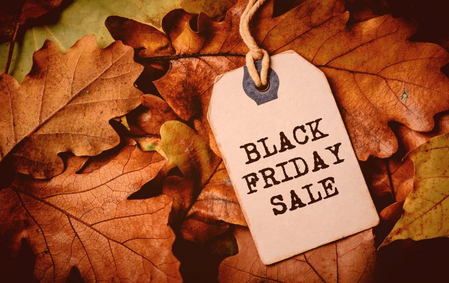 Back Friday tag on a bed of autumn leaves symbolising black friday sale still happening in 2020
