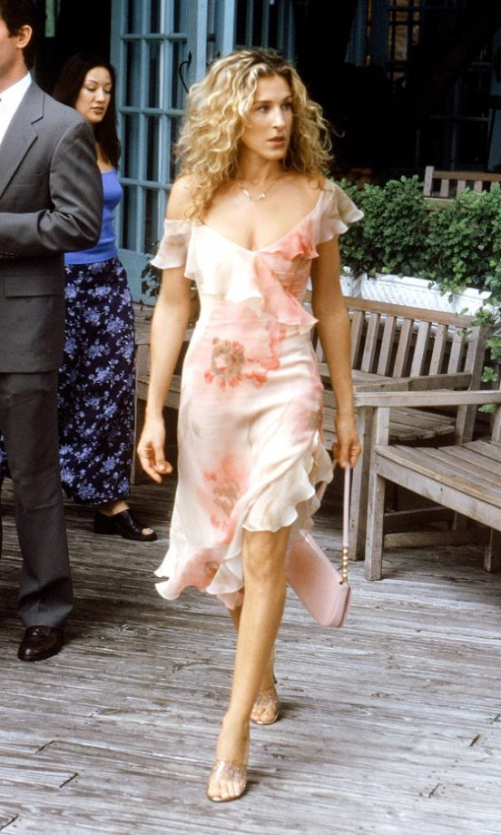 Carrie Bradshaw Wearing A Floral Dress And Carrying A Louis Vuitton Bag, Season 3
