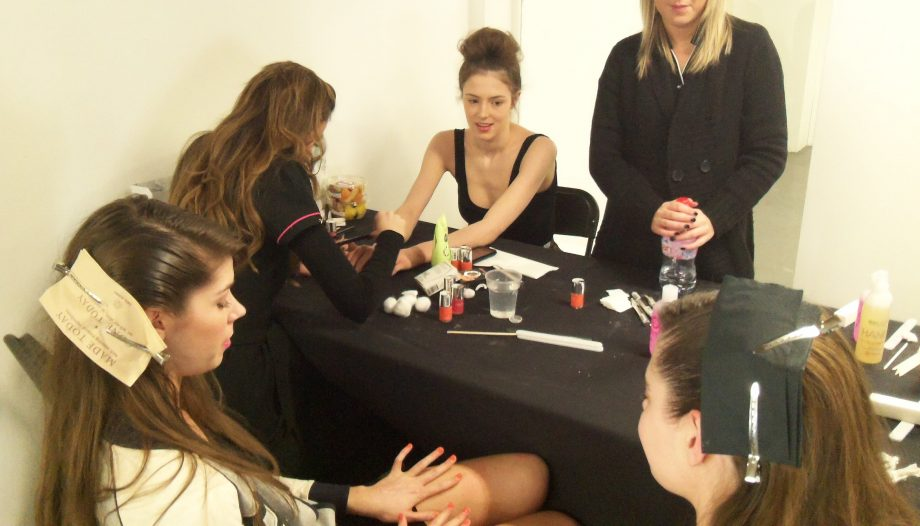 Models getting their nails painted with Nails Inc. Porchester Place backstage at the LOOK show