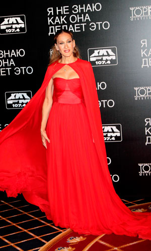 Sarah Jessica Parker wears a red Giambattista Valli haute couture gown and cape to the premiere of her latest film I Don't Know How She Does It