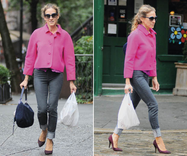 Sarah Jessica Parker wearing a pink jacket and heels while out shopping