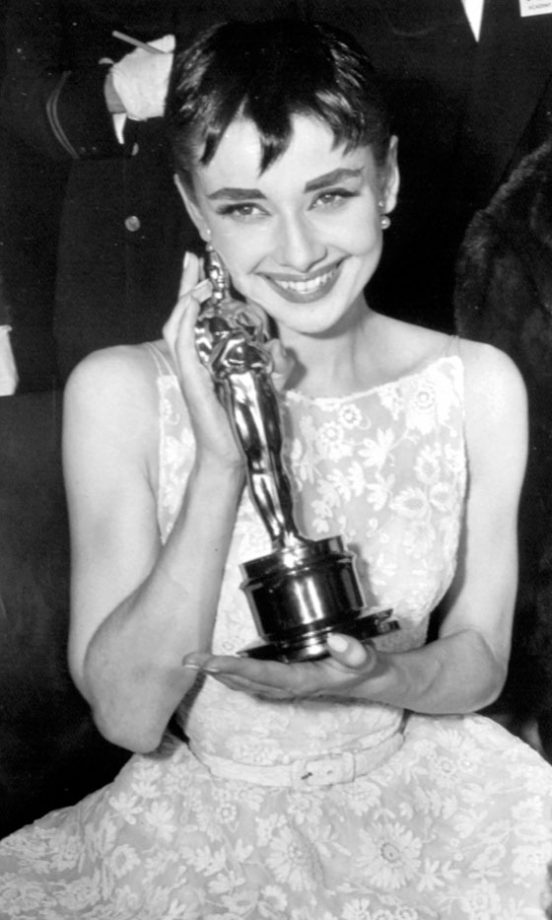 An Oscars Classic: Audrey Hepburn With Her Award For Roman Holiday At The 1954 Academy Awards