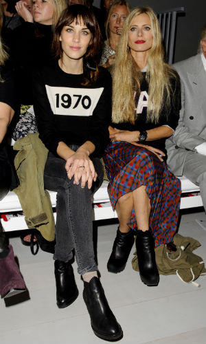 Alexa Chung and Laura Bailey both wearing motif jumpers on the front row at London Fashion Week
