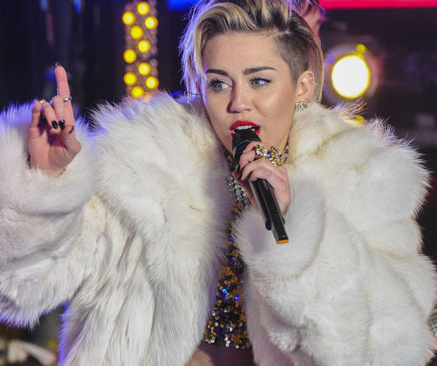 Miley Cyrus has denied she spoke about Beyoncé in an interview with LOVE magazine
