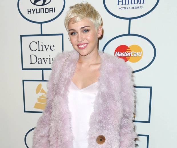 Miley looked pretty in pink Calvin Klein at the Clive Davis pre-Grammys bash