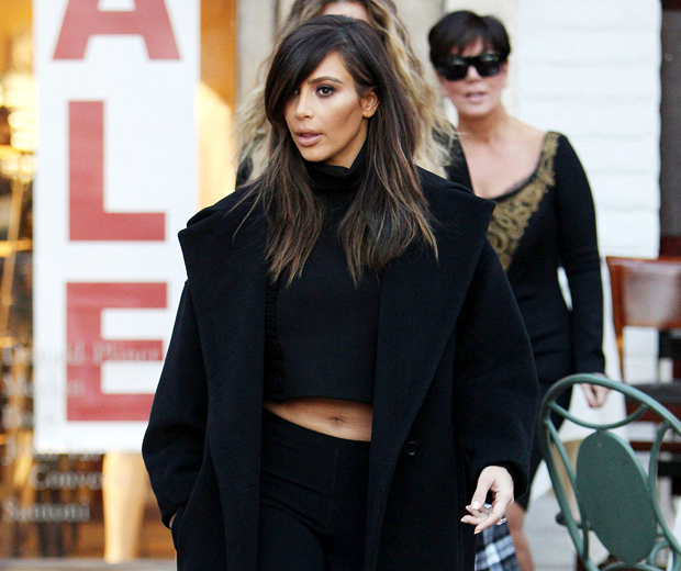 Kim worked a cropped top and pedal pushers while having lunch in LA