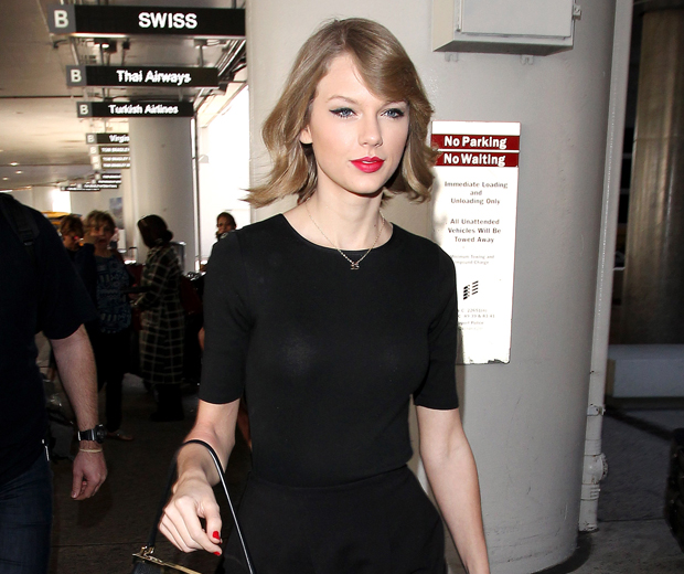 Swifty takes her new short hair out for its first outing as she touches down at LAX airport