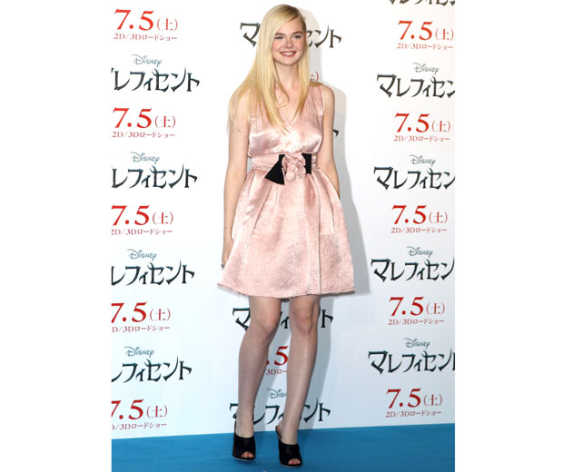 Elle Fanning looking stunning at Maleficent press conference in pink prom dress