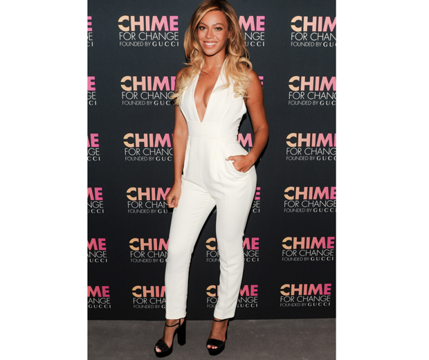 Beyonce looked sleek and chic in a plunging white jumpsuit at the Chime For Change party