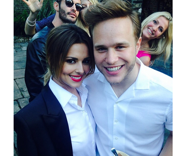 Cheryl and Olly Murs get photobombed by a rather handsome Frenchman...
