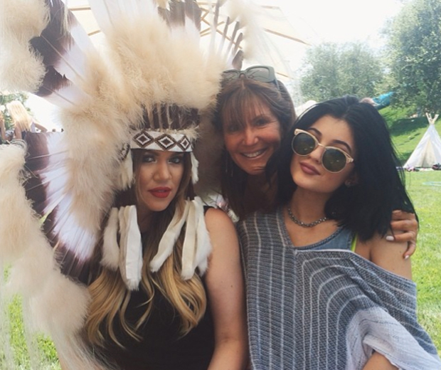 Khloe worked a huge feathered headpiece to baby Nori's first birthday party