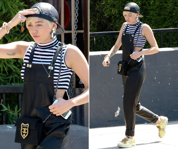 Miley works leather dungarees and Chanel accessories in LA