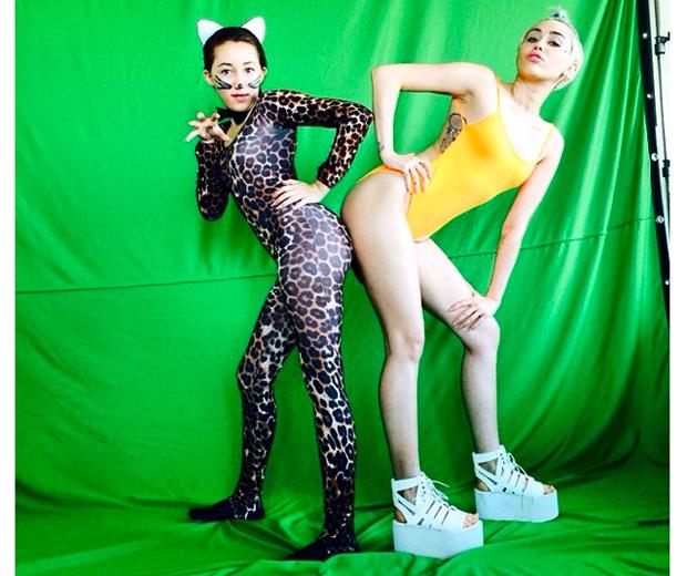Miley models Topshop's fluro swimsuit, £35