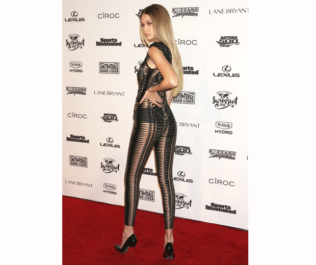 Gigi working a hot mesh bodysuit at the Sports Illustrated Swimsuit Issue launch in New York...