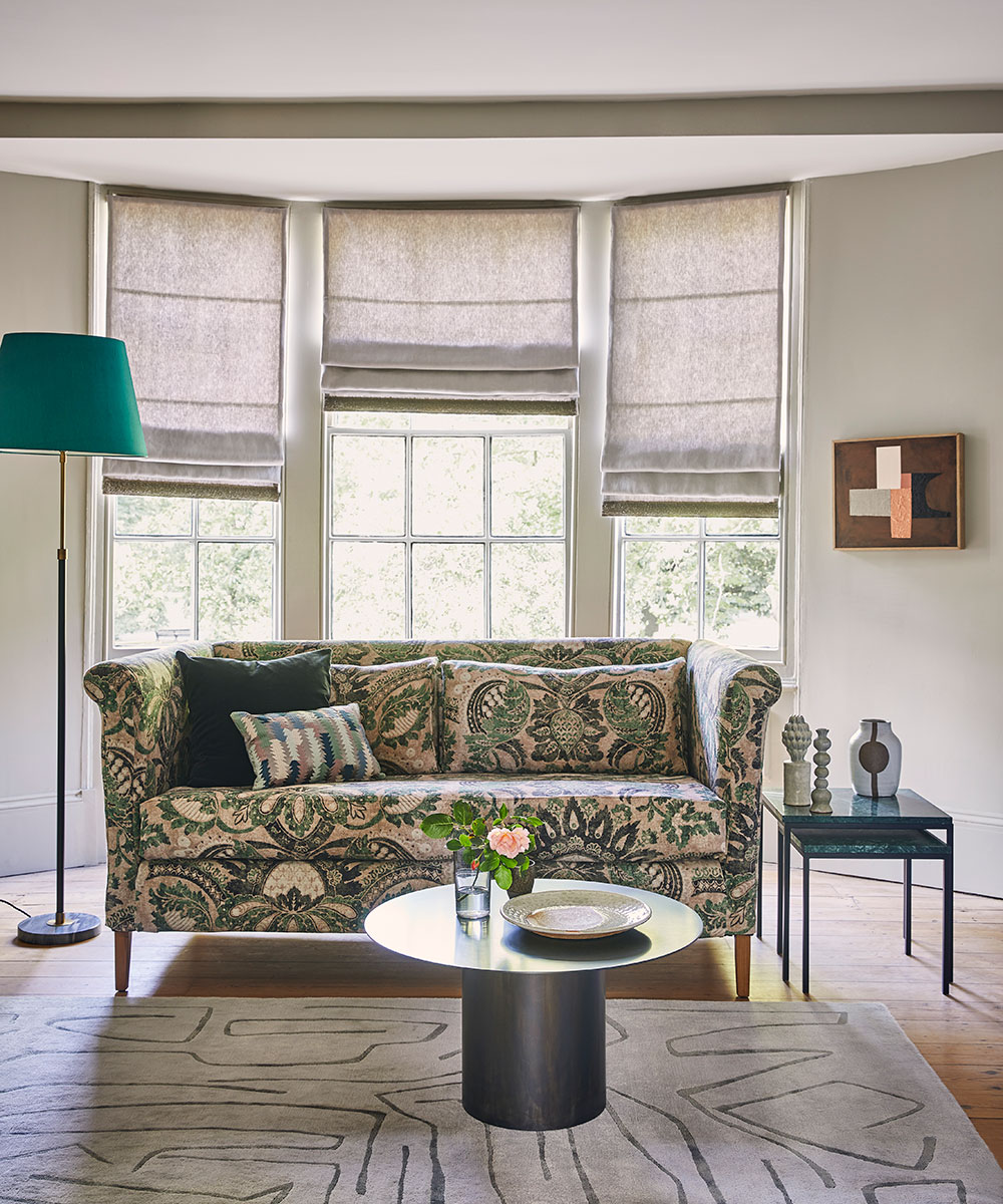 See this classic living room with elegant furniture and upholstered sofa