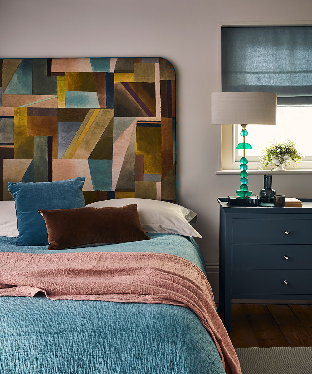 Small bedroom with abstract-patterned headboard | Homes & Gardens