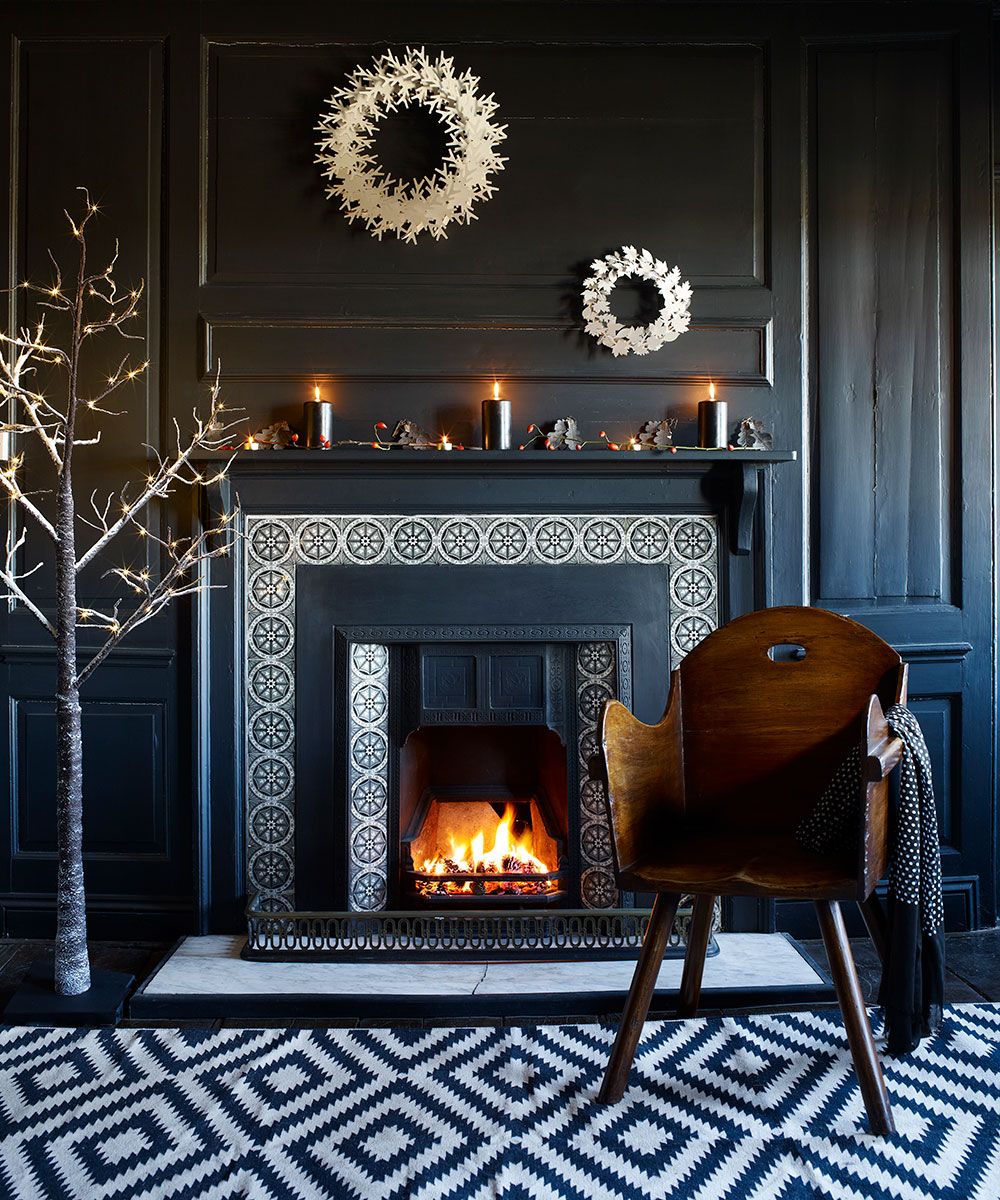 Glamorous fireplace wood panelled walls and tile surround | Homes & Gardens