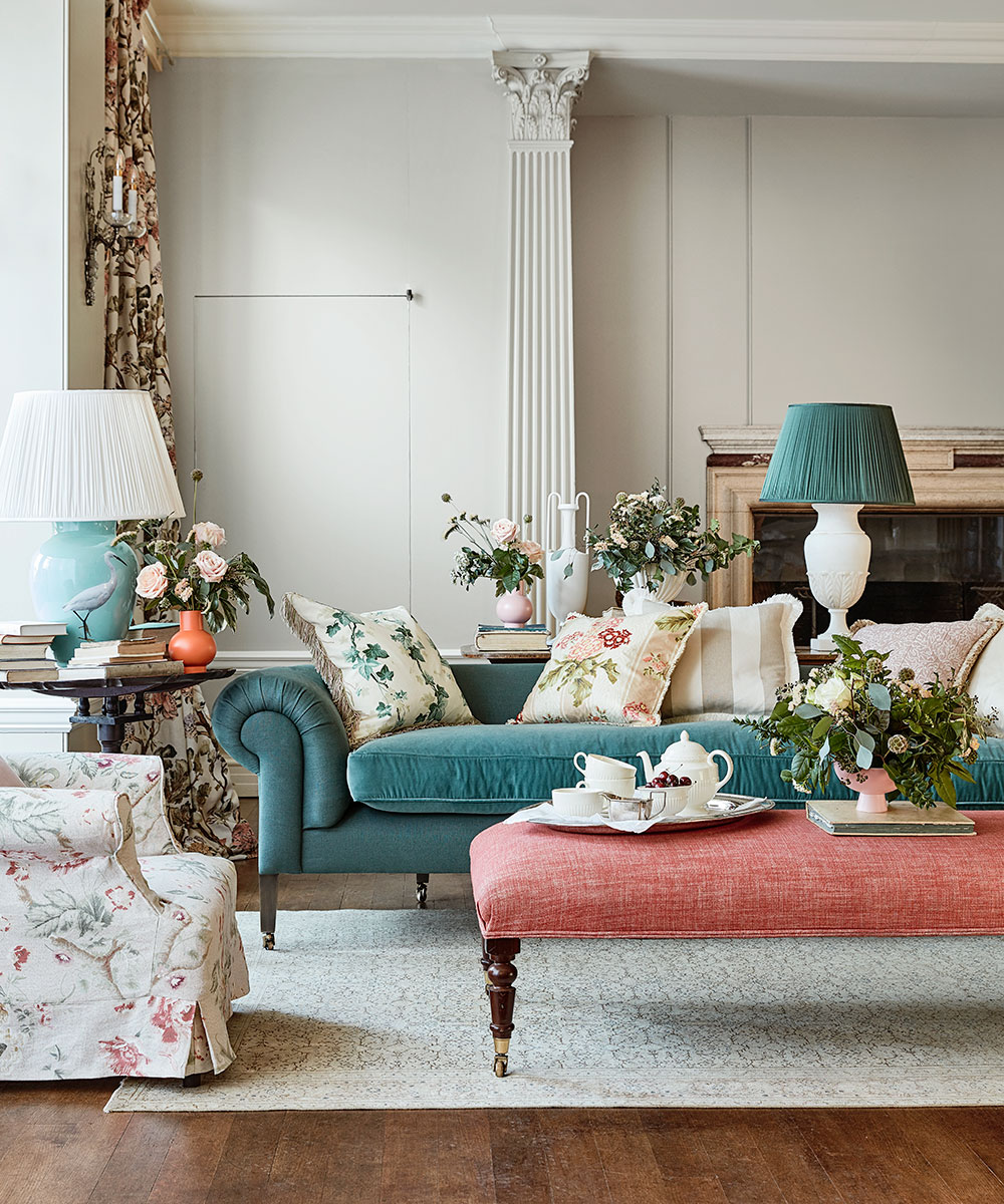 Browsr this classic British-style living room with weathered furniture and delicate embroidery